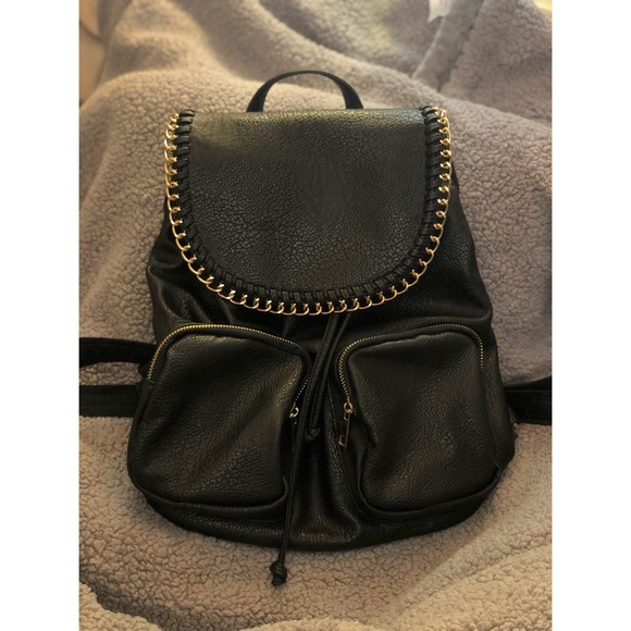 b2cecd72174 Black faux leather with gold chain backpack